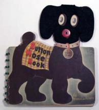 Button Nose Book is a felt-covered cardboard dog with a real button nose