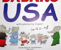 Photos of the sites collaged with original Babar illustrations create clever design for this reissue of Babar Comes to America.